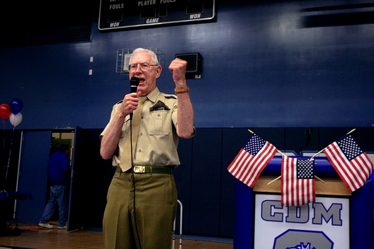 WWII veteran Dick O'Brien cheers on his group of students that dressed up in military garb for the Living History luncheon at Corona del Mar High School.