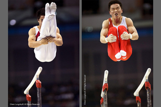 Phuoc Hung Pham (Vietnam) left and Yoo Won Chul (Korea) right show double piked and double tucked dismounts while competing on Parallel Bars at the 2009 London World Artistic Gymnastics Championships.