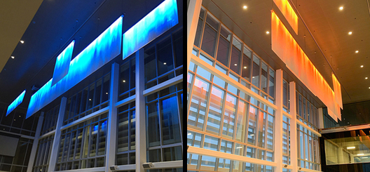 Continuous large scale atrium feature pendant, acrylic panels with reflective media incorporating RGB LED