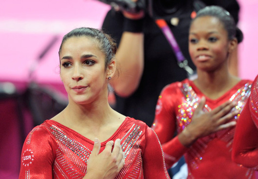 Alexandra Raisman and Gabrielle Douglas (USA) wait expectantly for the results of the team competition during the women event at the London 2012 Olympic Games.