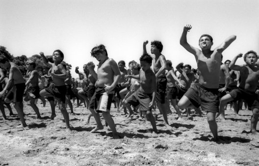 ©Tamara Voninski. Maori boys perform a Haka, traditional war dance for men who were launching a Maka, traditional war canoe in Waitangi, New Zealand on Waitangi Day.  There is currently a renaissance of traditional Maori culture in New Zealand.  Maori children are taught their language and customs by elders.  