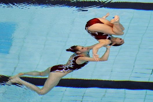 Pamela Fischer and Anja Nyfeeler (Switzerland) set up a difficult move from under the water during their routine at the European Champions Cup Syncronised Swimming event at Ponds Forge Sheffield, May 2011,