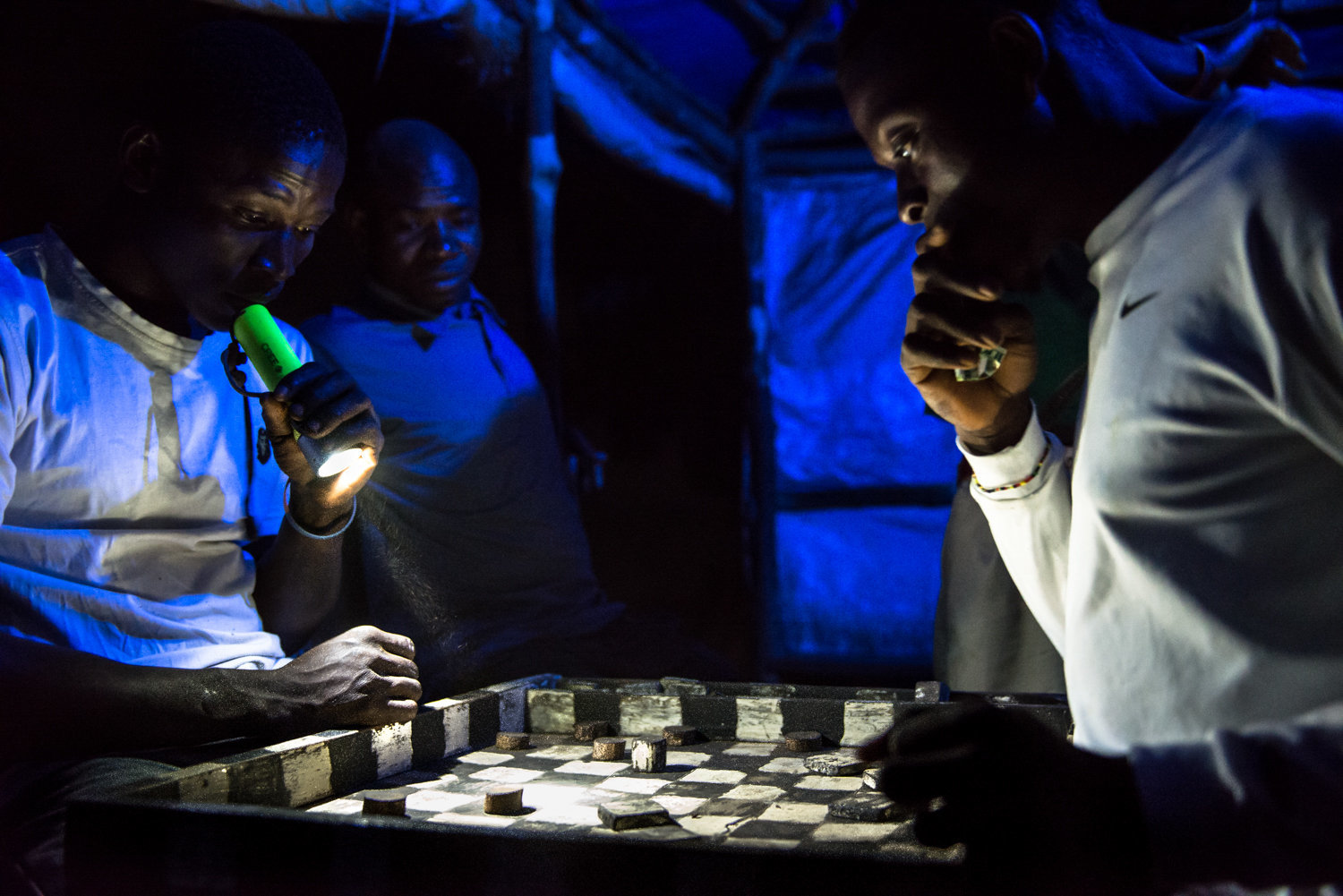 Local fishermen gather in the evenings at the beachfront club to play checkers.