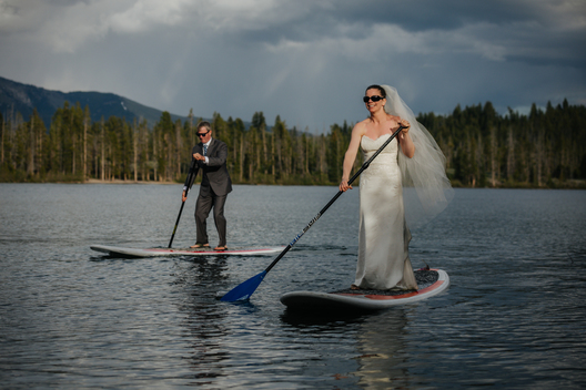 SUP wedding in Idaho with adventure wedding couple