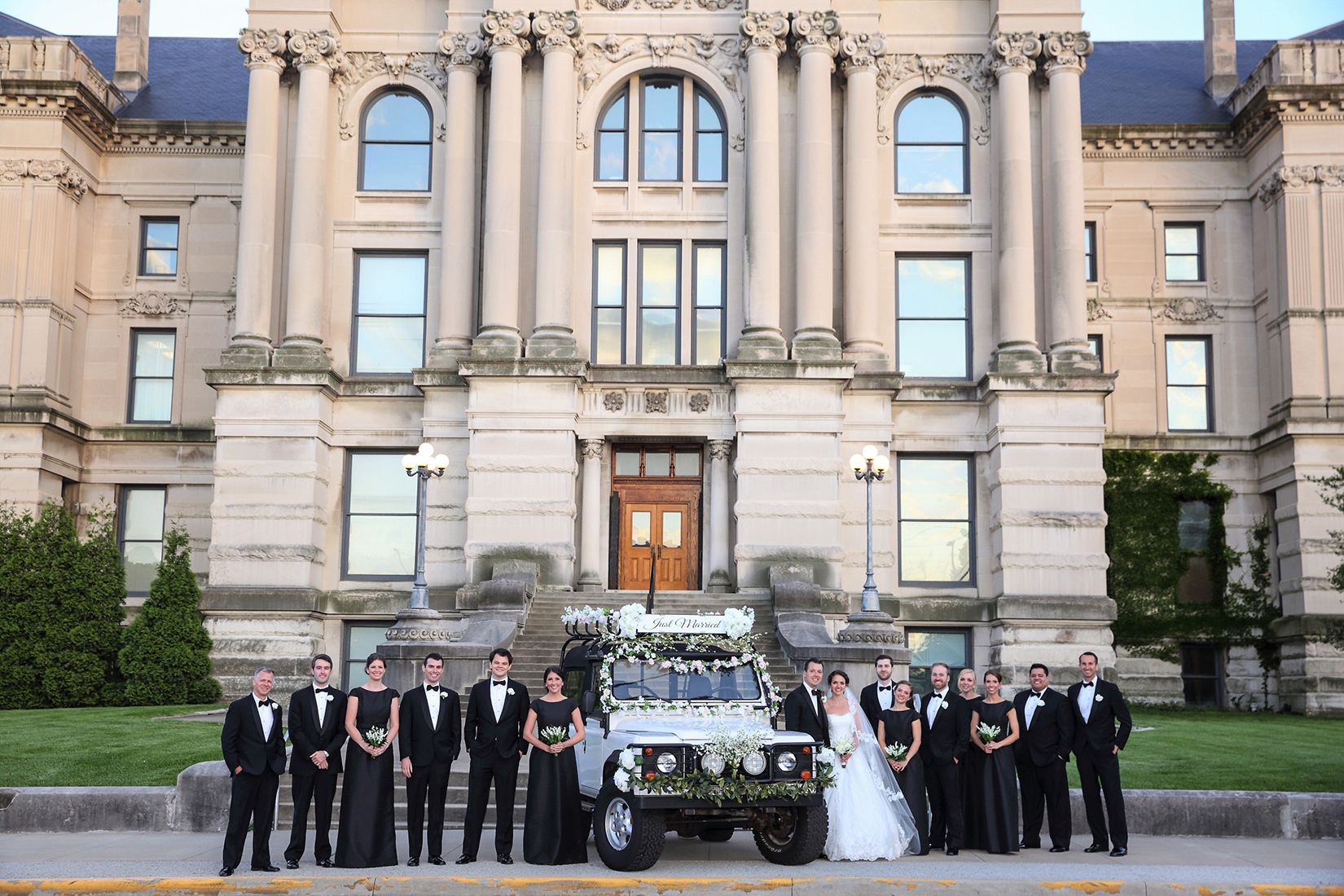 old courthouse evansville in wedding party with car