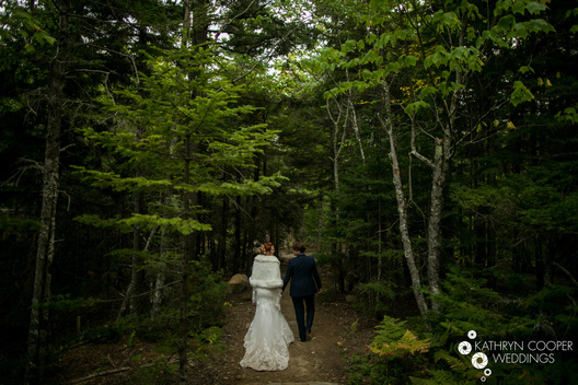 Beautiful lesbian couple hiking through woods in Acadia NP, Maine - Kathryn Cooper Weddings