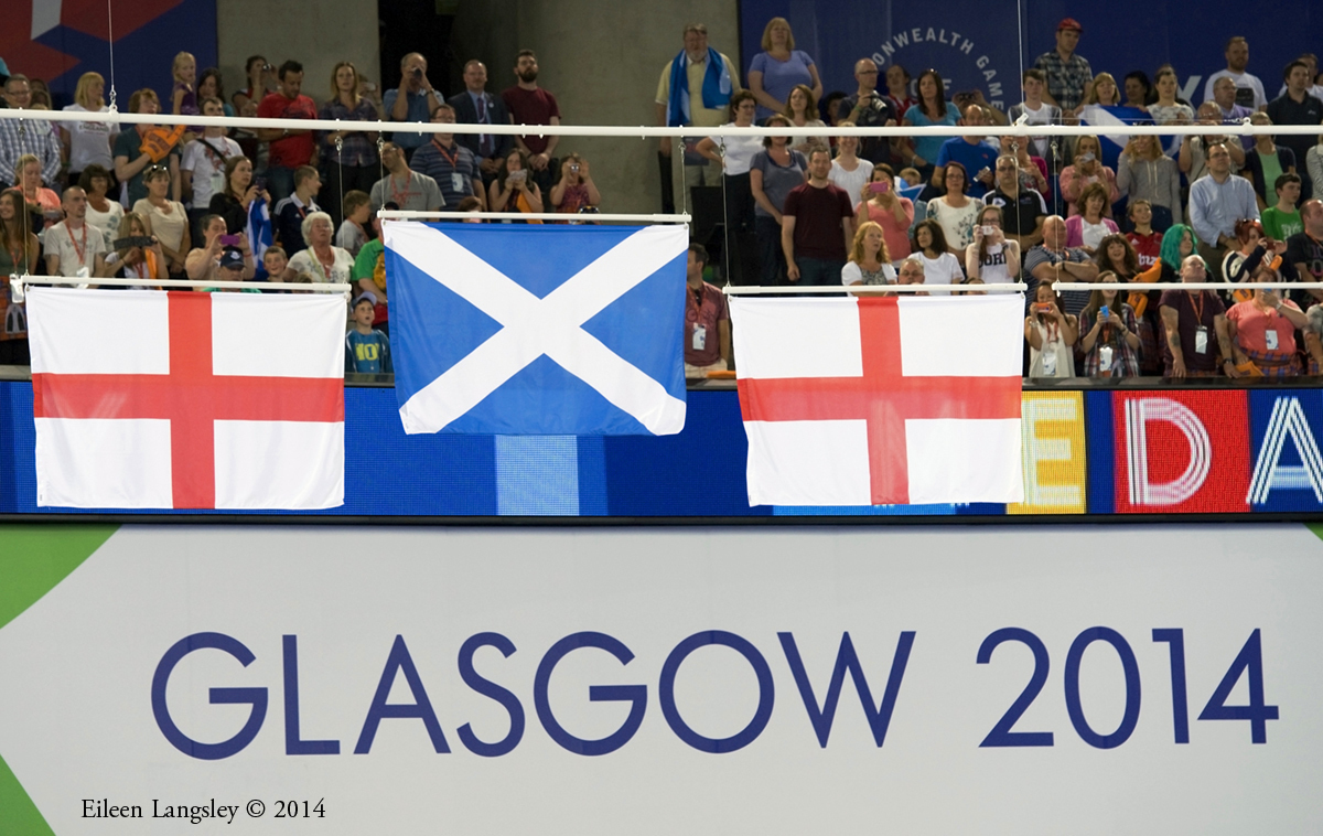 The flags of the medallists in the pommel horse final (Scotland gold, England silver and bronze) at the 2014 Glasgow Commonwealth Games.