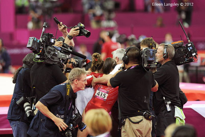 The USA women are completely surrounded by TV caeras and pool photographers after winning the team competition during the gymnastics competition of the London 2012 Olympic Games.