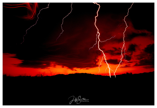 While out in the Tohono O'odham Nation, lightning was landing 50' away from us, using my Nikon camera with a wide 28mm lens, I captured this image. AT Willett and I experienced one of the closest bolts that either of us had photographed.  We both captured it from different perspectives at the same time. 1990