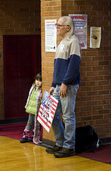 Spectators listen to Ron Paul at a town hall meeting in the Mason City High School Gym.