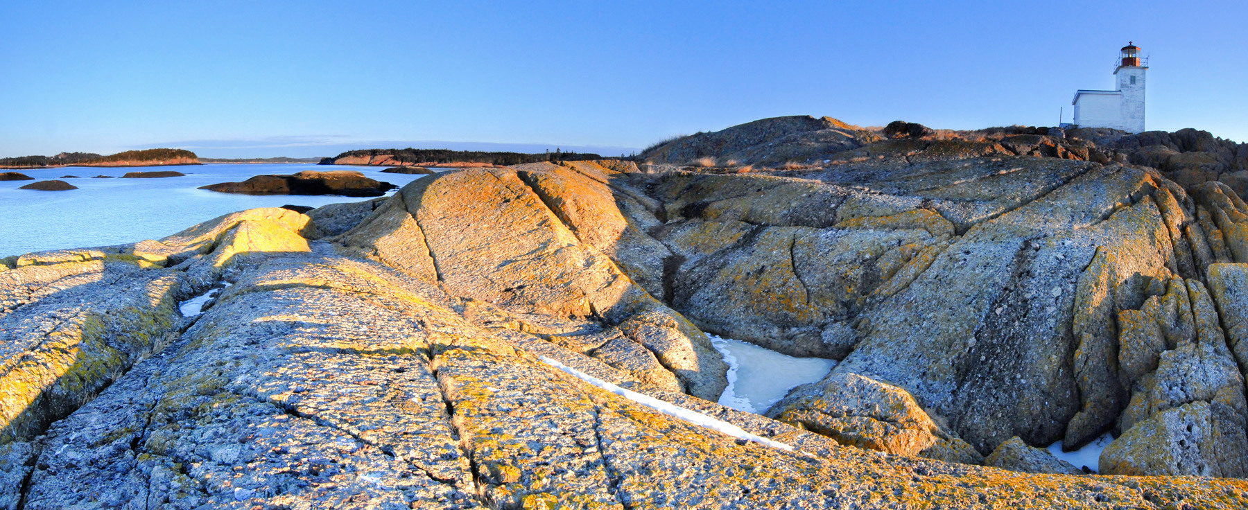 This is a panorama of Pea point light house from its southern ledges.  It was actually quite a warm winter day and I had a great time soaking up the sounds, sights and sun.  The smoothed out bedrock that surround the light show evidence of glacial pavement; areas where the rock is relatively smooth with the exception of many shallow parallel grooves in its surface where the last glacier grinded across it.
