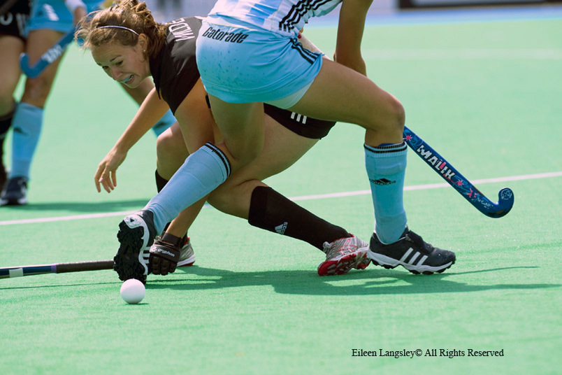 A cropped action image of Germany's Celine Wilde finding herself under pressure during their match against Argentina at the 2010 World Cup in Nottingham.