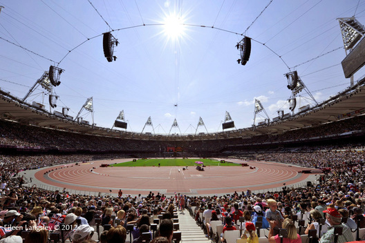 A wide view of a packed Olympic Stadium at the 2012 London Olympic Games.