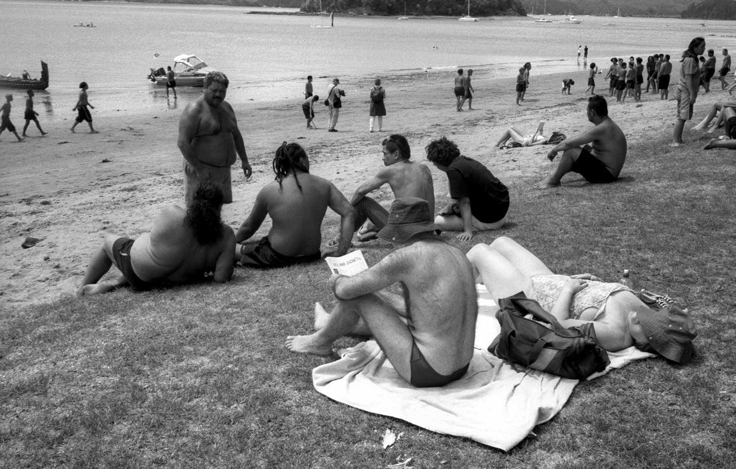 ©Tamara Voninski. People on the beach in Paihia, New Zealand in the Bay of Islands.  In 2005, the New Zealand government passed the controversial Seabed and Foreshore legislation to prevent Maori from claiming exclusive ownership of New Zealand2019s resource rich coastline and seabed. The Maori traditionally see themselves as caretakers of the land and coastline.  The Maori population is approximately 530,000 of four million New Zealanders.