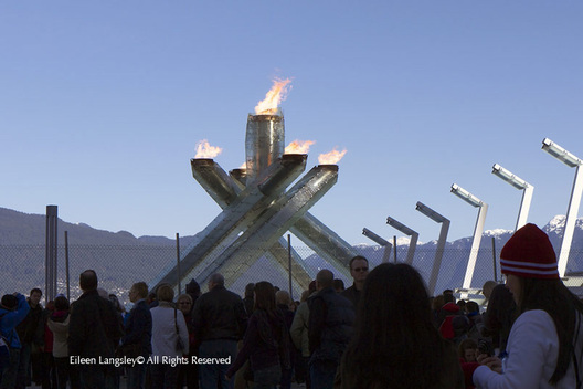 The Olympic Flame burns in the cauldron at the Waterfront in Vancouver protected by security fencing much to the frustration of residents and visitors.