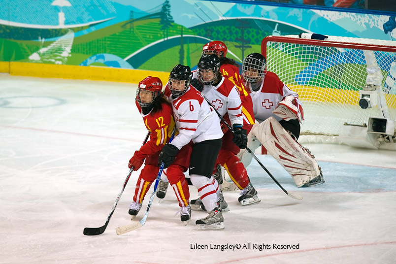 Swiss and Chinese players line up to attack or defend the goal during their match at the 2010 Winter Olympic Games in Vancouver