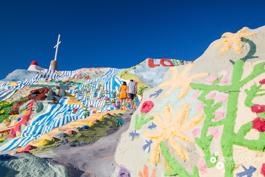Unique places to take engagement photos in California with Salvation Mountain wedding photographer Kathryn Cooper Weddings
