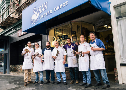 (L-R) Andrew Idiart, Brian Dwyer, Erik Wideman, Steve Sancimino, Marino Peradotto, Kevin Sancimino, and Tom Sancimino pose for a photo outside Swan Oyster Depot in San Francisco, Calif. on Tuesday, April 2, 2019.