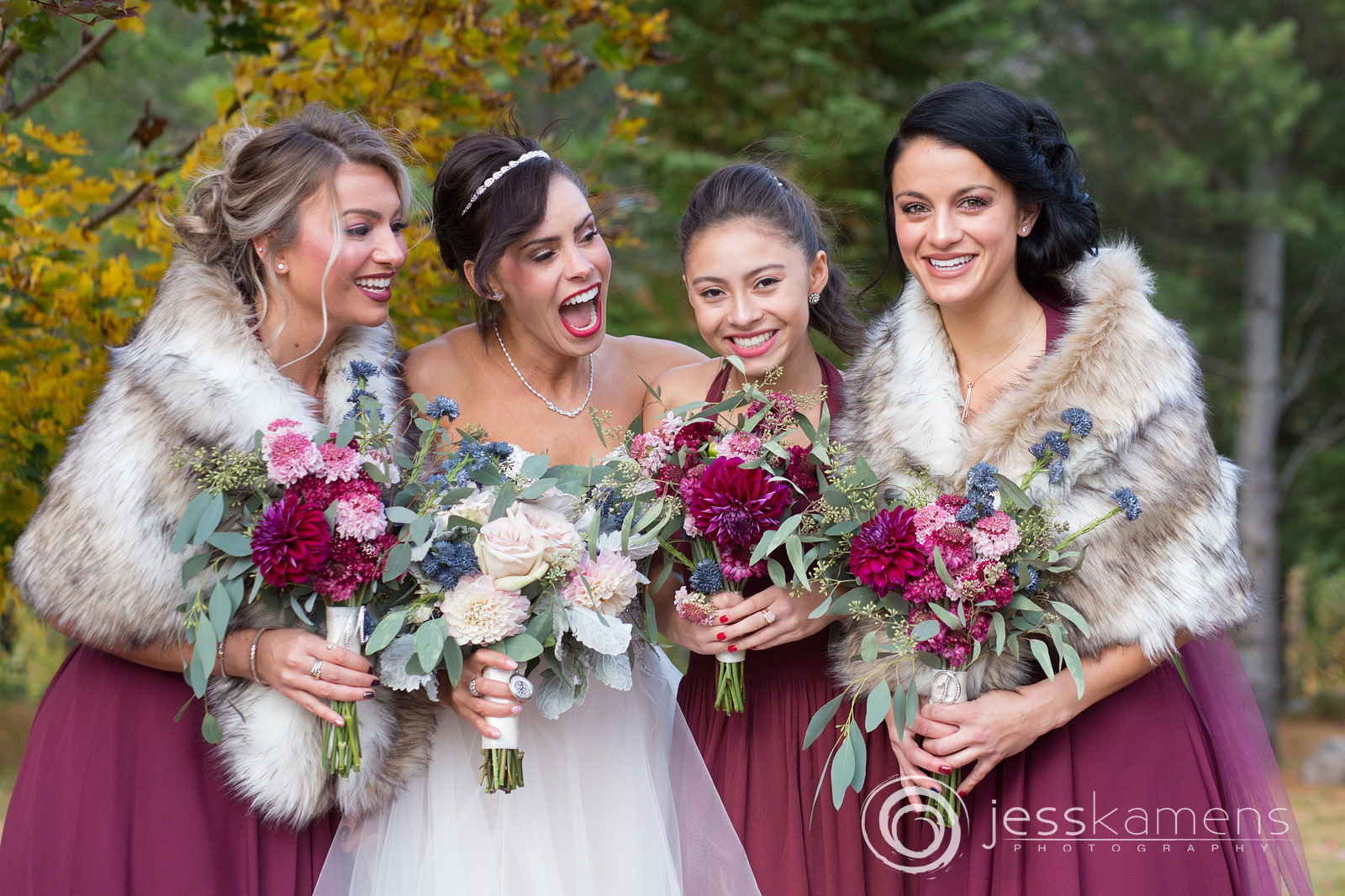 bridesmaids and maid of honor celebrate with their friend
