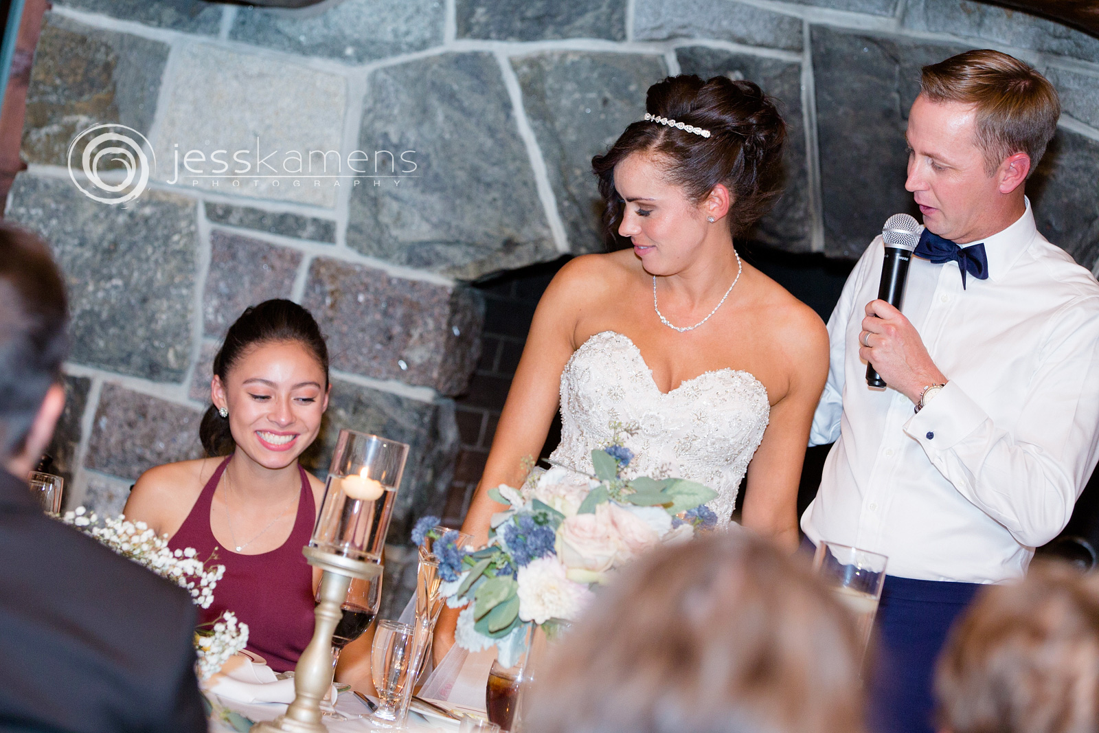 bride and groom celebrate with their daughter