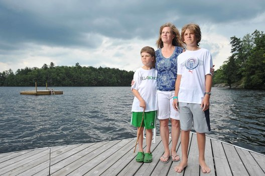 MACLEANS-BARKWAY-08.14.11-PARRY SOUND, ONTARIO: Cindy Barkway with her sons David Jr. 9 (l) and Jamie 12 (r) spend most of their summers at the family cottage on Blackstone/Crane lake just south of Parry Sound Ontario. Cindy's husband David was one of the few Canadians killed at the WTC on Sept 11.