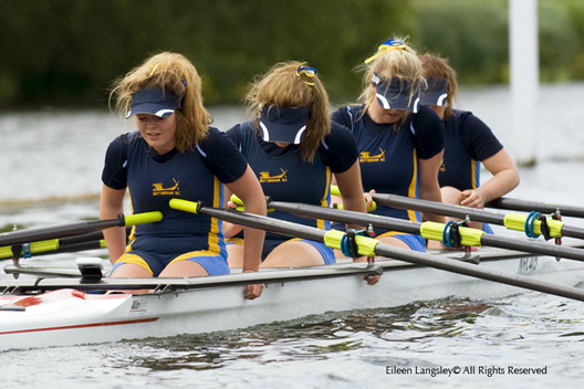 The J16 Coxless Four Crew of Nottingham Rowing Club are exhausted at the end of their race at the 2010 Women's Henley Regatta.