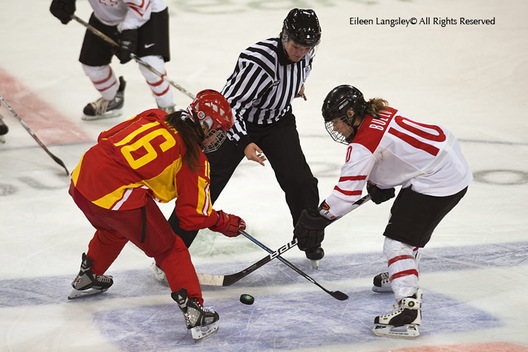 Swiss and Chinese players face off during their match at the 2010 Winter Olympic Games in Vancouver