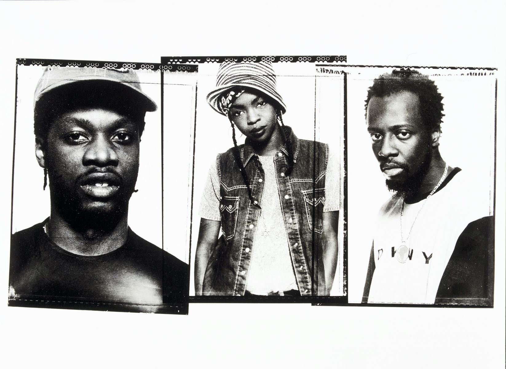 Portrait of Wyclef Jean, Pras & Lauryn Hill of The Fugees photographed in the mid 1990's.