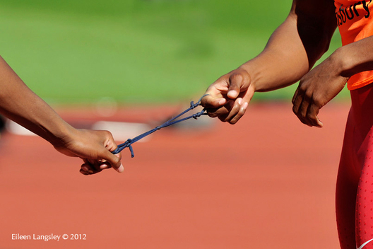 A cropped generic image of the hands of a blind runner and his guide and the strap that holds them together during the Athletics competition of the London 2102 Paralympic Games.