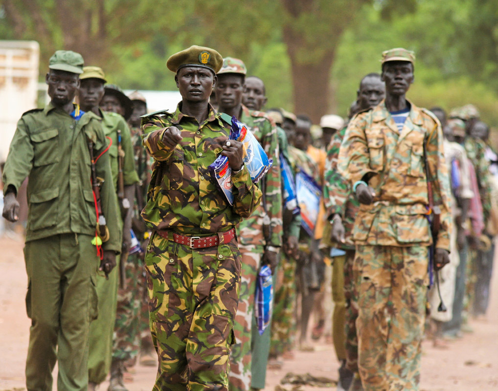"A contingent of the Sudan People's Liberation Army (SPLA) marches with mosquito nets in hand to demonstrate to the public that, ""We defended our country, now we will protect our families from malaria."" The ""Celebrating Today's Conquerors, Nurturing Tomorrow's Heroes"" campaign was implemented by the US-based non-profit organization, Population Services International, in partnership with the South Sudan Ministry of Health.
