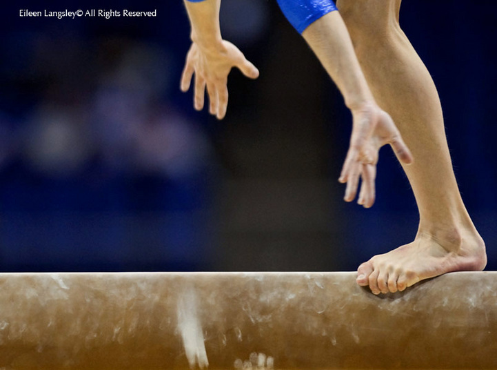 A generic image of the feet of a gymnast almost overbalancing while competing on the balance beam at the 2009 London World Artistic Gymnastics Championships at the 02 arena.