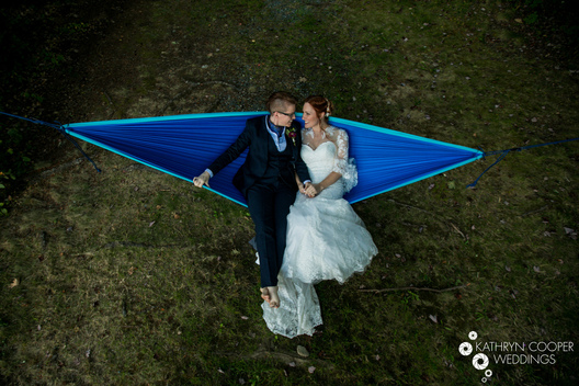 Unique wedding ideas of couple in hammock - Kathryn Cooper Weddings photographer perspective for LGBT wedding
