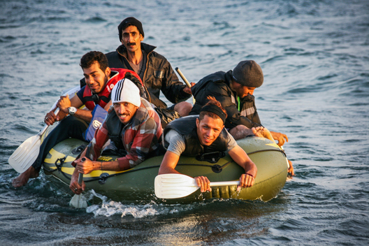 Refugees from Iran finally arrive on the Greek island of Kos after paddling seven hours across the choppy Mediterranean waters that separate Europe from the Turkish seaside resort of Bodrum. More than 1,011,700 refugees arrived in Europe by sea in 2015.