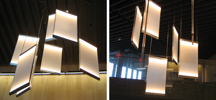 Linear LED and acrylic panel custom stairwell feature pendant cluster