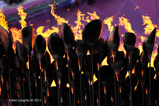 The Olympic Flame burning in the cauldron at the stadium at the 2012 London Olympic Games.