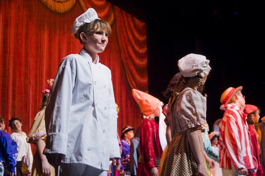"Paige Mills, 12, looks out toward the audience with a smile while performing ""My Son Pinocchio, Geppettos Musical Tale"""
