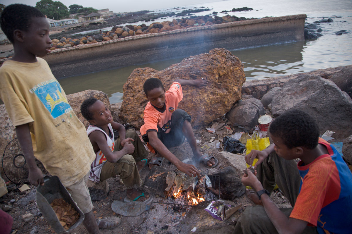I end the day with a group of Fulani boys grilling fresh fish on a makeshift grill.  My very first 24 hours in Dakar... absolutely magnificent.