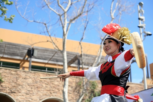 A KAYPA (Korean American Youth Performing Artists) dancer performs a Korean traditional drum dance at the 16th Annual Sage Hill School Multicultural Fair on Saturday.