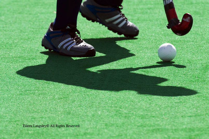 A cropped generic image of the shadow of a player's shadow with the ball perfectly balanced on the stick at the 2010 Women's World Cup Tournament in Nottingham.