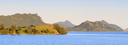 Warm evening light illuminates Motukiore Island and Whangarei Heads