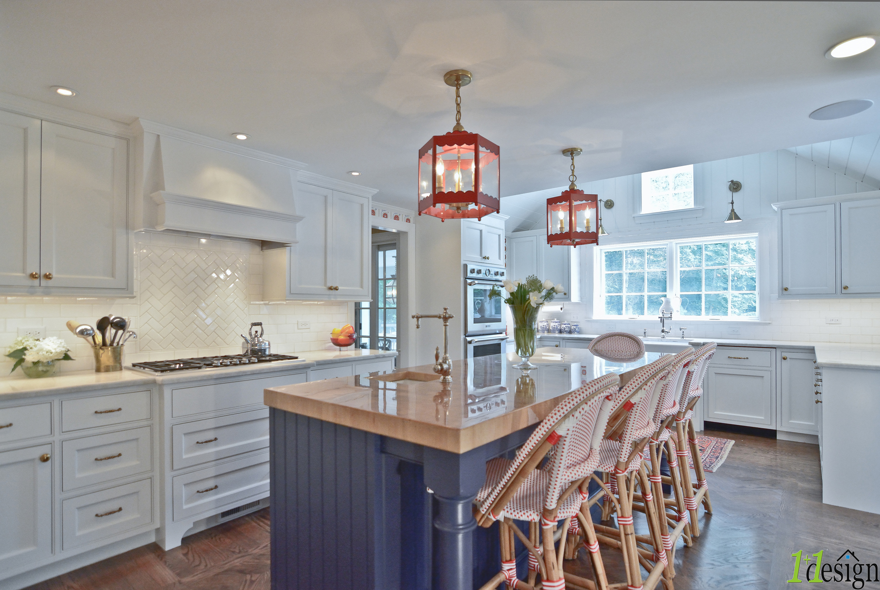a new colorful kitchen addition / renovation accommodates a large island with seating and ample storage.