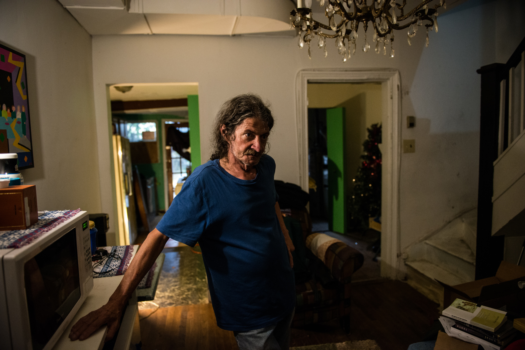 Mike Davis inside his home on US1.  The house is an $850 per month rental in sore need of being brought up to city code.