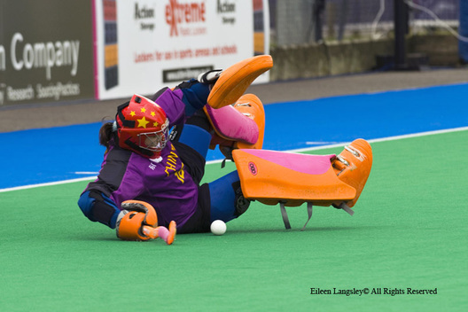 China's goalkeeper Ma Yibo takes a tumble saving a shot at goal during their match against Argentina at the 2010 Women's World Cup Hockey Tournament in Nottingham.