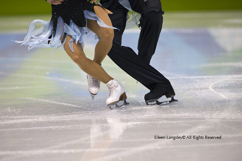 A generic cropped action image of the feet and boots of ice dancers competing in the 2010 Winter Olympic Games in Vancouver