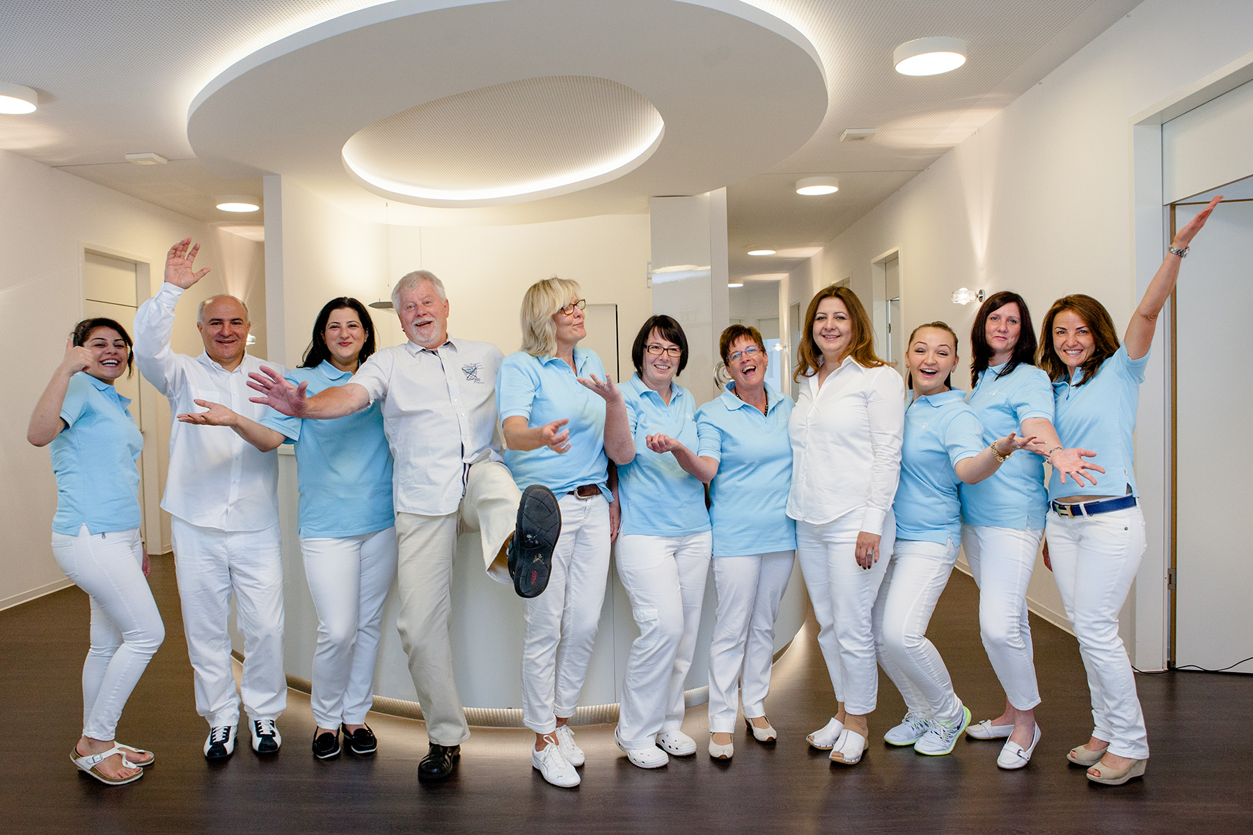 corporate branding image of a dentist office and the employees jumping and having fun