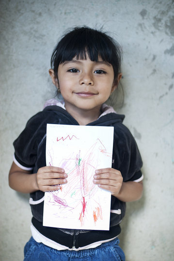 Valeria proudly holds up a drawing she drew for the children in Northfield, Minnesota.