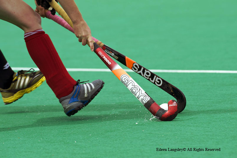 A cropped generic action image of an England player getting to the ball first but finding the way out blocked by an New Zealand player during their match at the 2010 Women's World Cup Hockey Tournament.