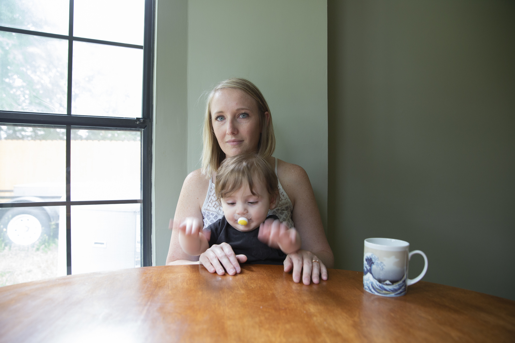 Kylie Mohr in her home with her son Lincoln Mohr