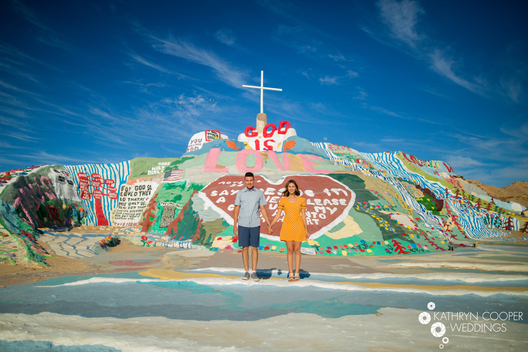 Colorful wedding photography California - Salvation Mountain engagement photos