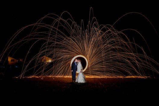 Unique wedding photographer idea with fire spinning - wedding photo for LGBT wedding